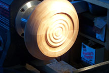 A segmented bowl gets its base adorned
